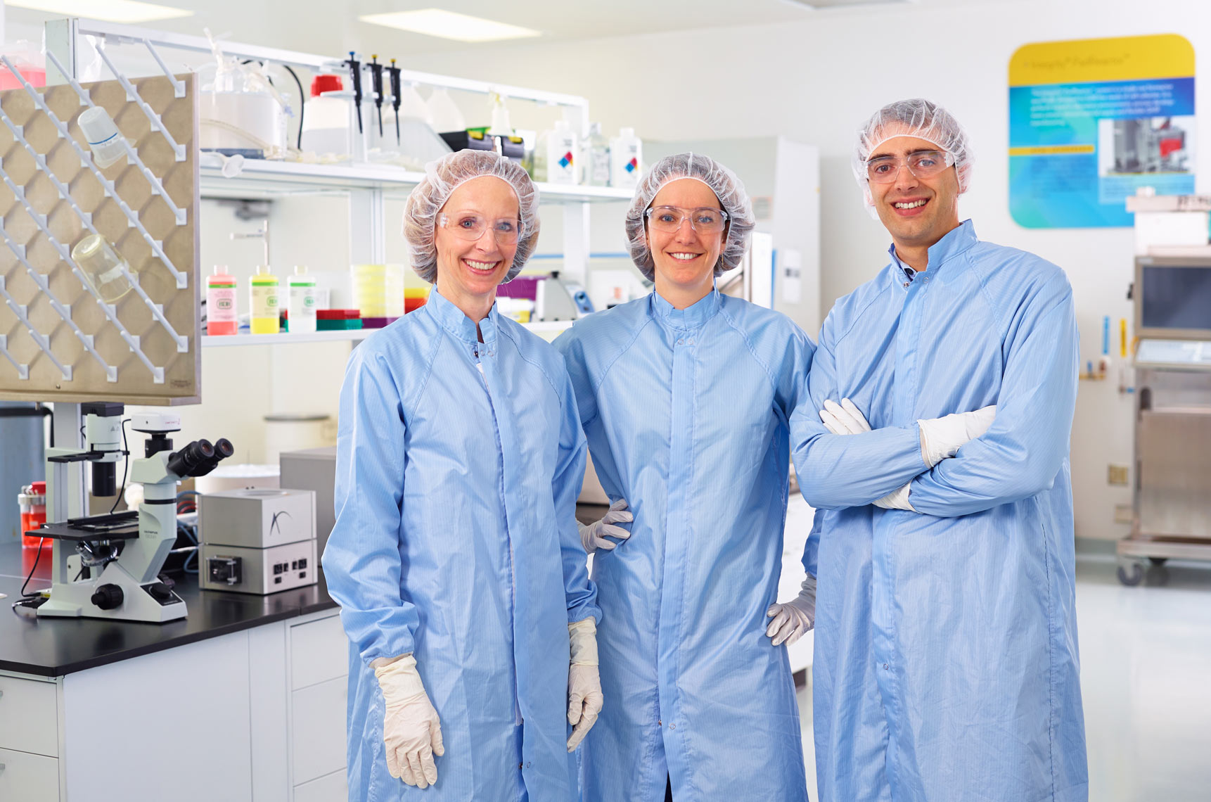 ATMI/lab techs/standing looking at camera/medical photography