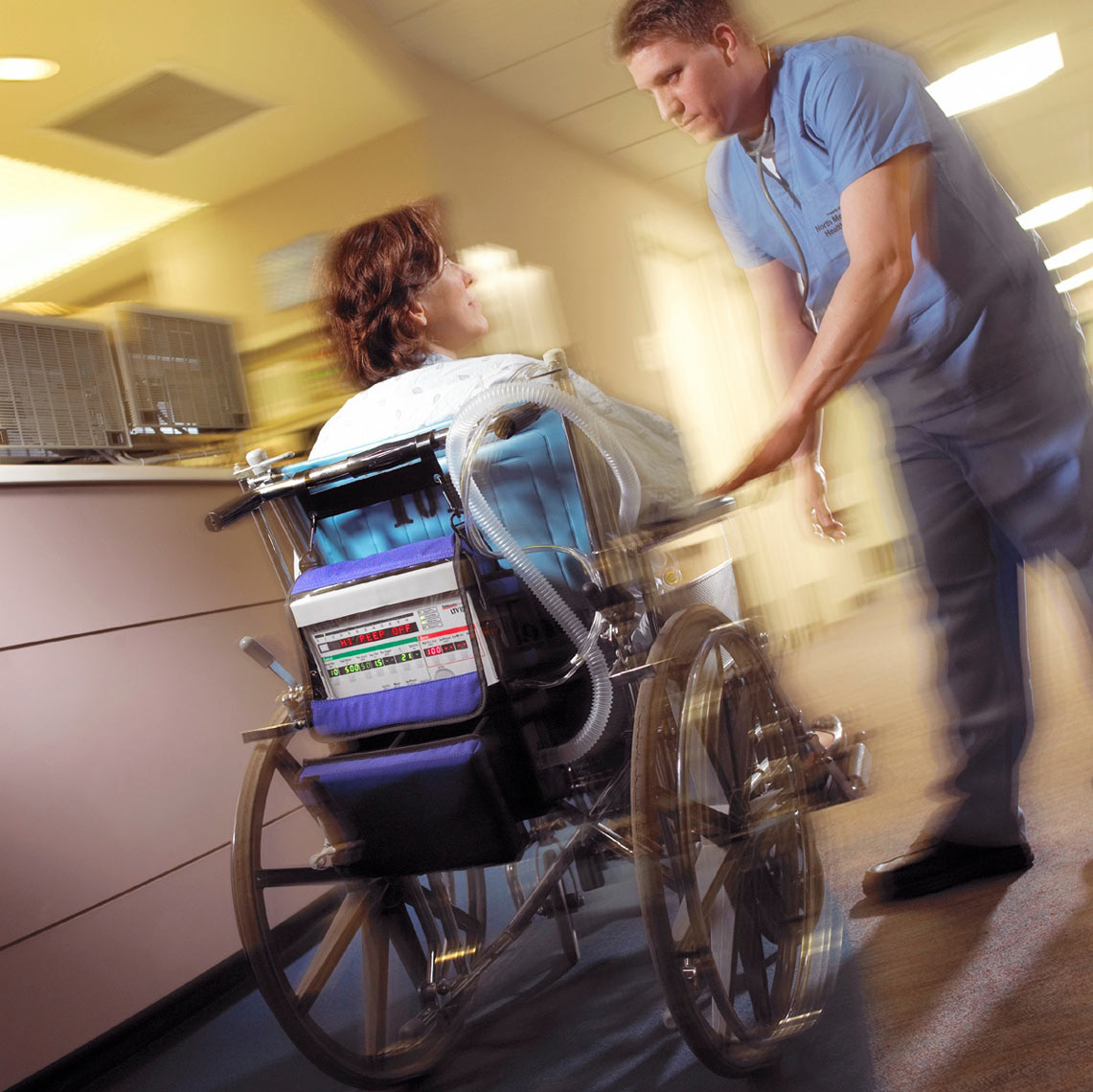 Wheelchair patient in ER/ER Docotor reasuring/Location Medical photo