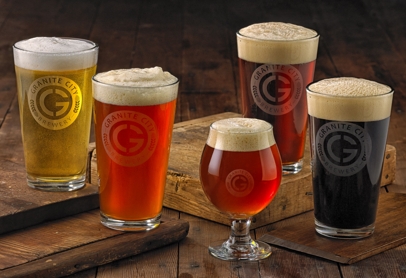 Granite City beer in glasses.  Each glass has a different flavor of beer. Food photography, InsideOut Studios.