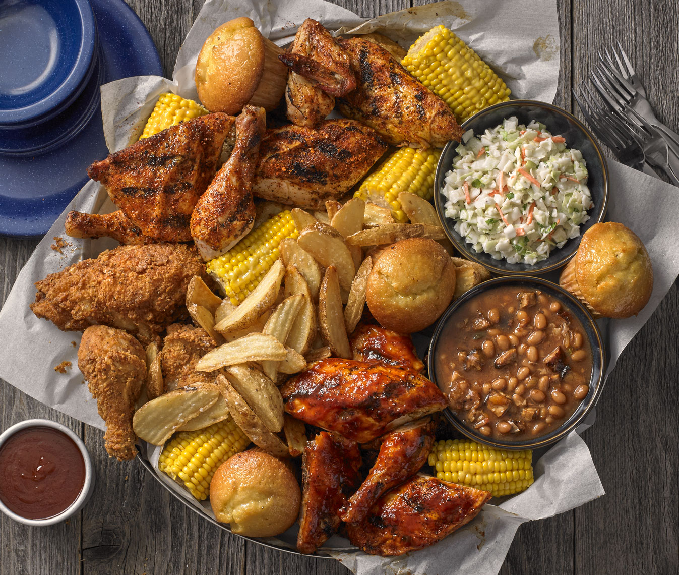 BBQ chicken/various sides/top down on wood/food photography