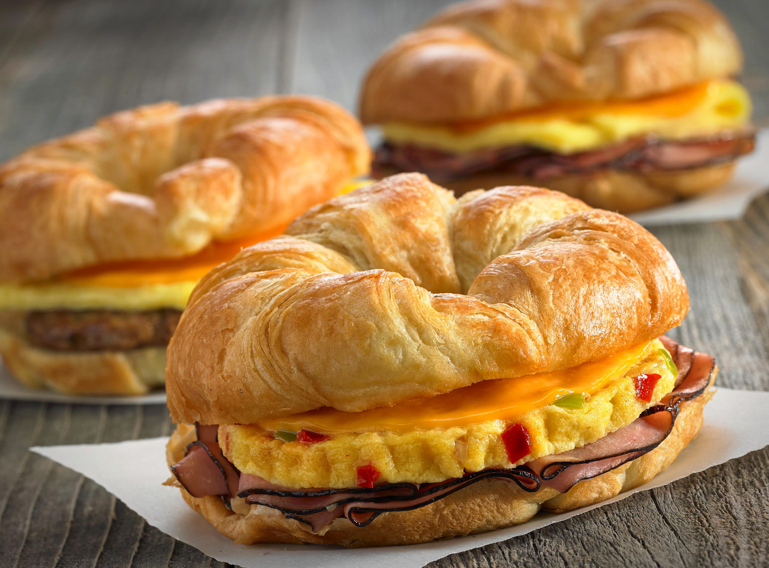 Croissant Breakfast sandwiches/grey barnwood table/food photography