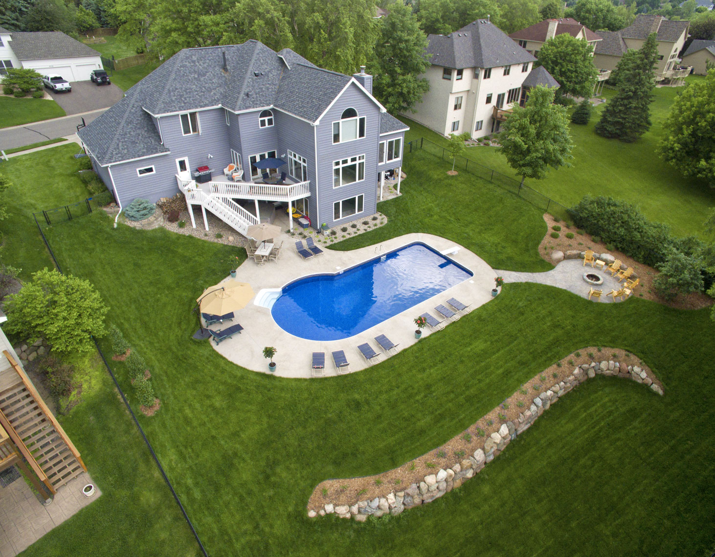 3 story grey house/pool/white deck/arial drone photography