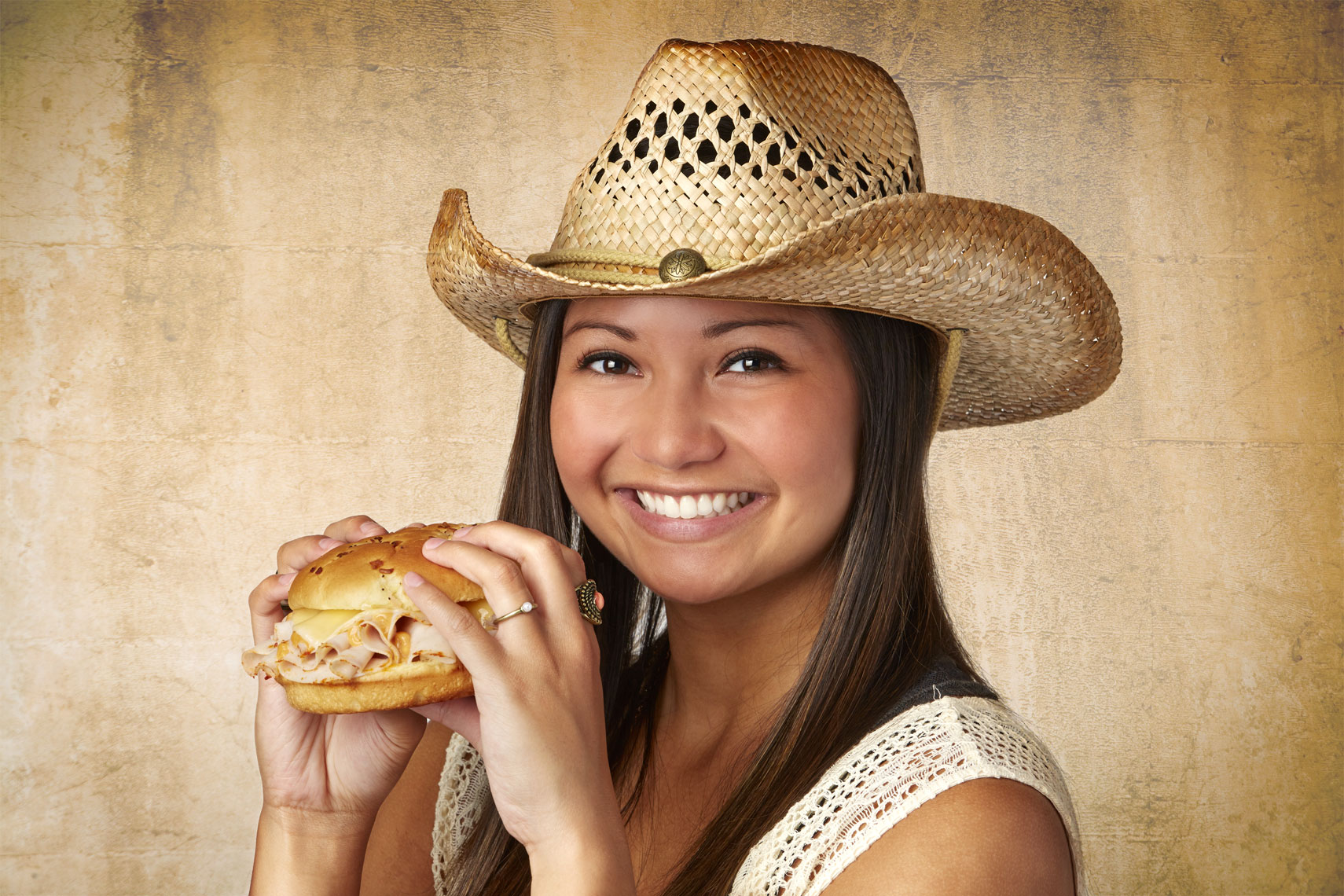 Female model/eating ham & cheese sandwich/lifestyle photo