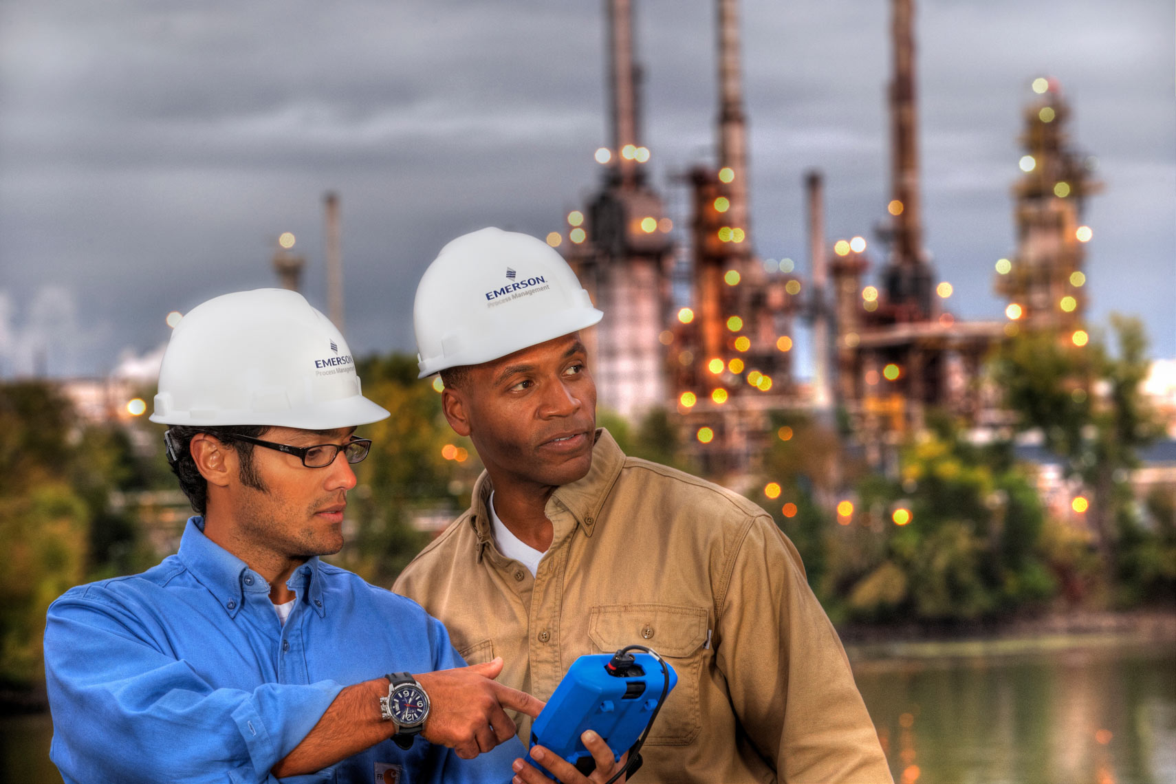 Oil Refinery/Two men talking/twighlight shot/Industrial photo