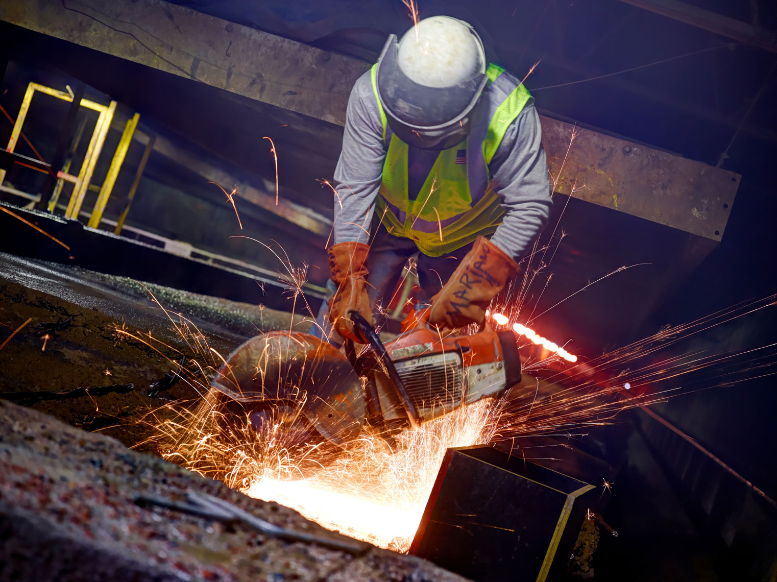 Fabcon Plant/Worker/ Lg saw/sparks flying/Indusrial photography