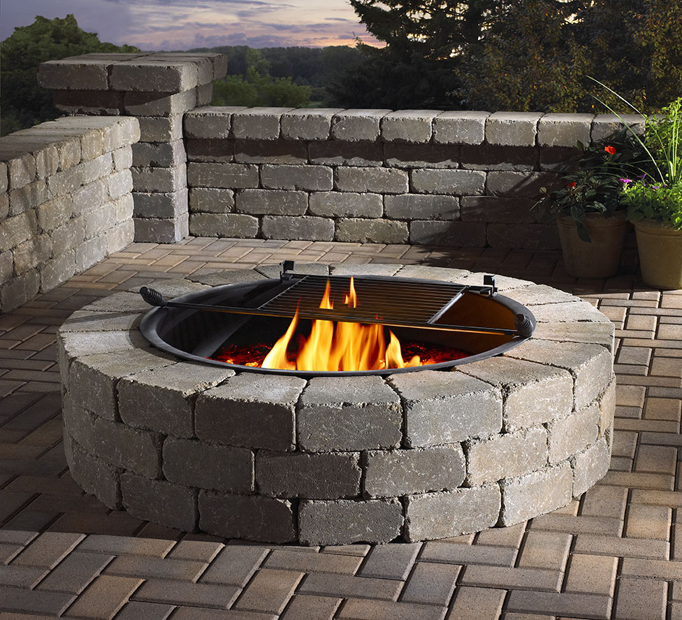 Round firepit/brick/brown pavers/brick wall/studio set photography