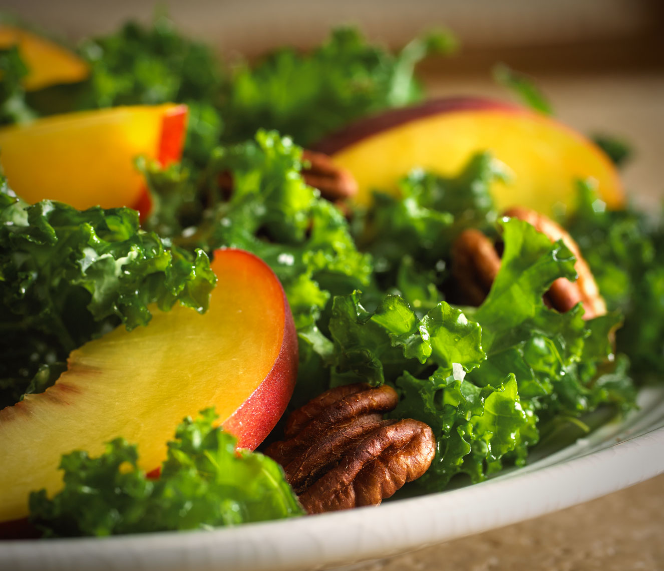 Walnut peach salad/large peach slices/walnuts on bed of greens/food photography