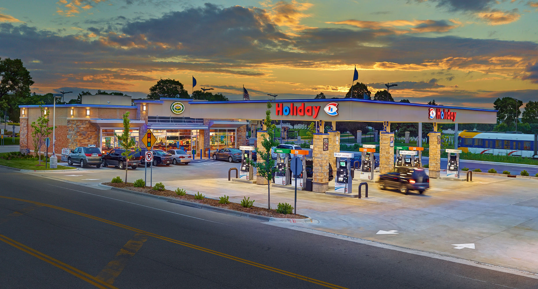 Holiday gas station/pumps/store in background/architectural photo