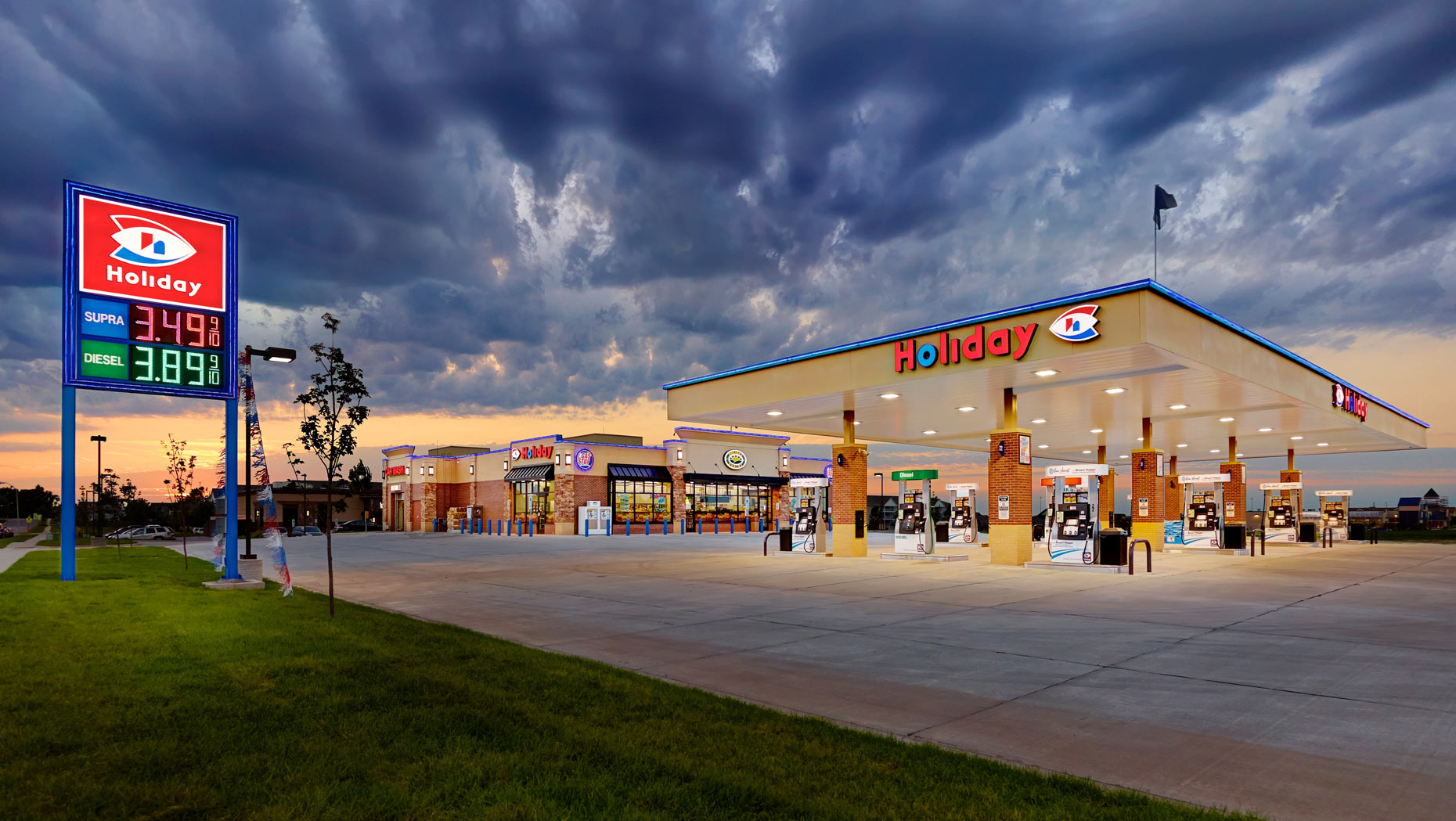 Holiday Station/gas pumps/dynamic sunsetarchitectural photo