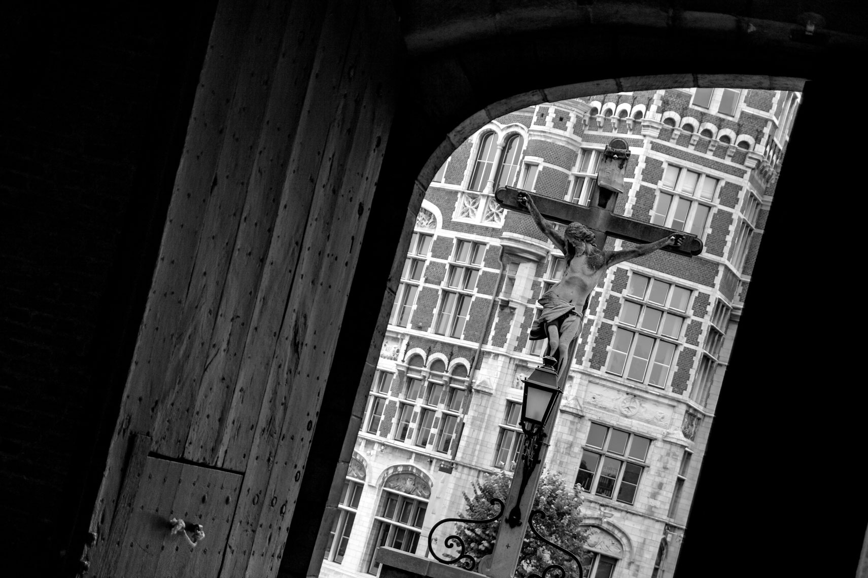 Christ/cross/view out doorway/Location photography