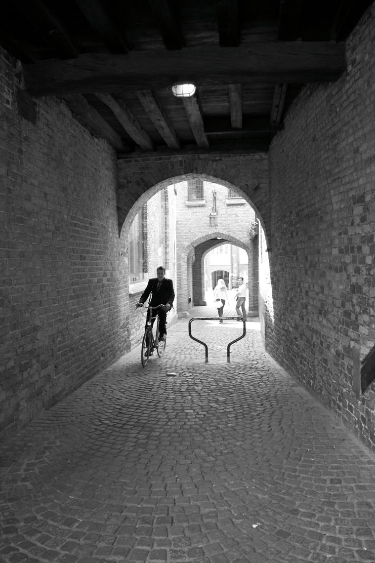 Man on bike/Brick tunnel/Black and white/Location photography