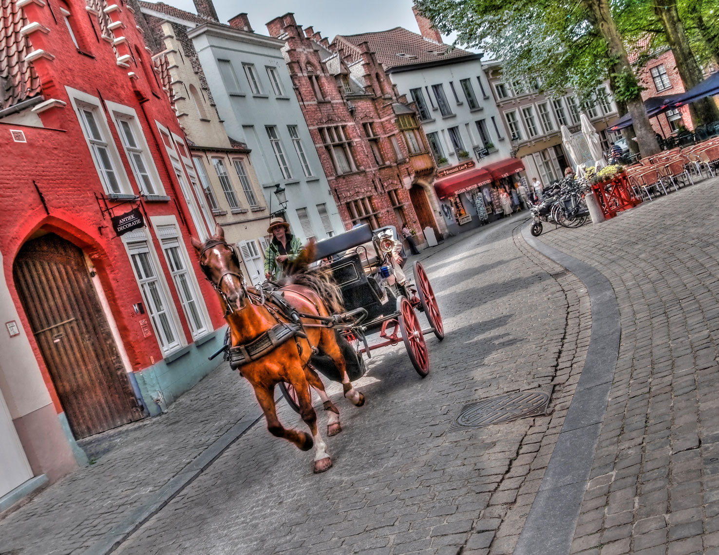 Horse and buggy/cobblestone sidewalk/old buildings/location photography