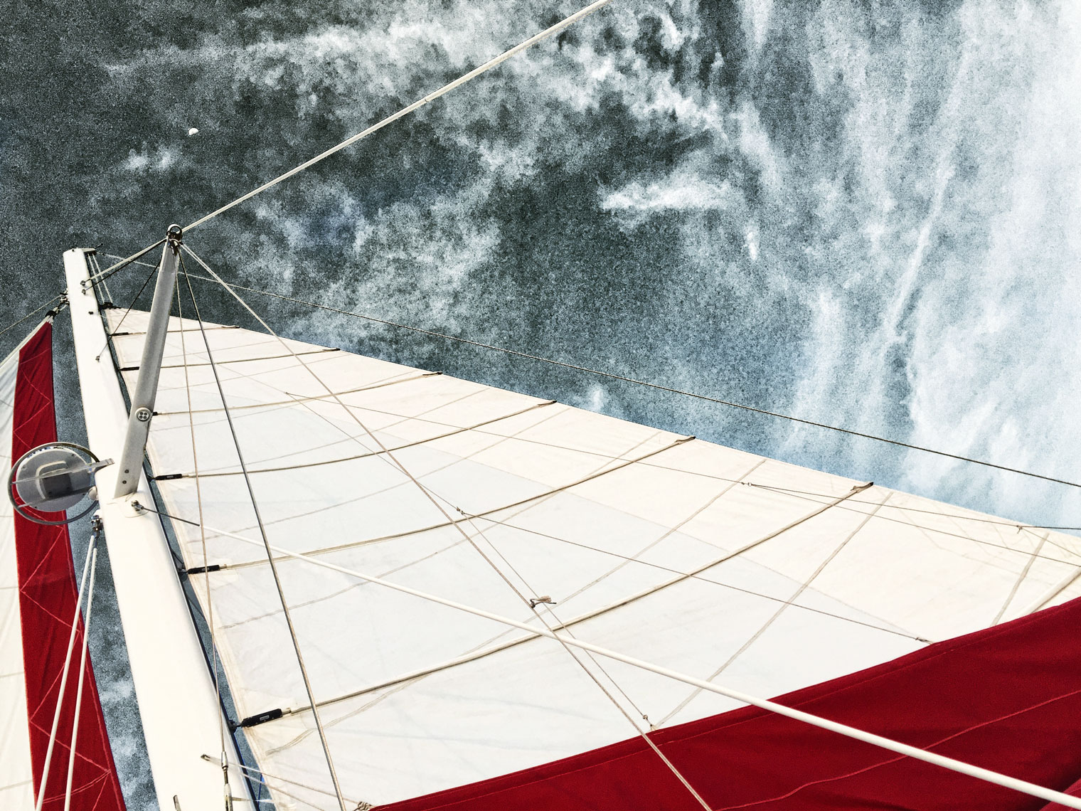 White and red sail/looking skyward/locaton photography