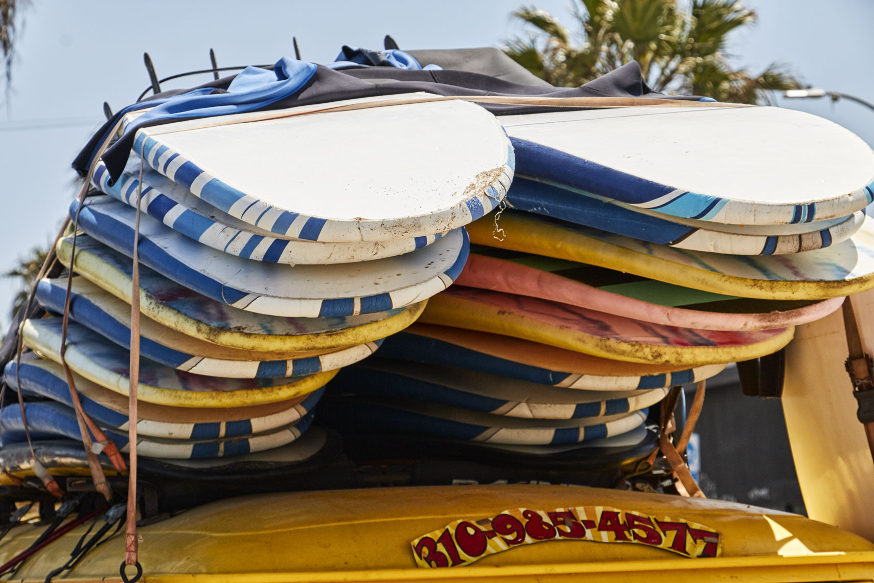 Stack of surf boards/top of car//locaton photography