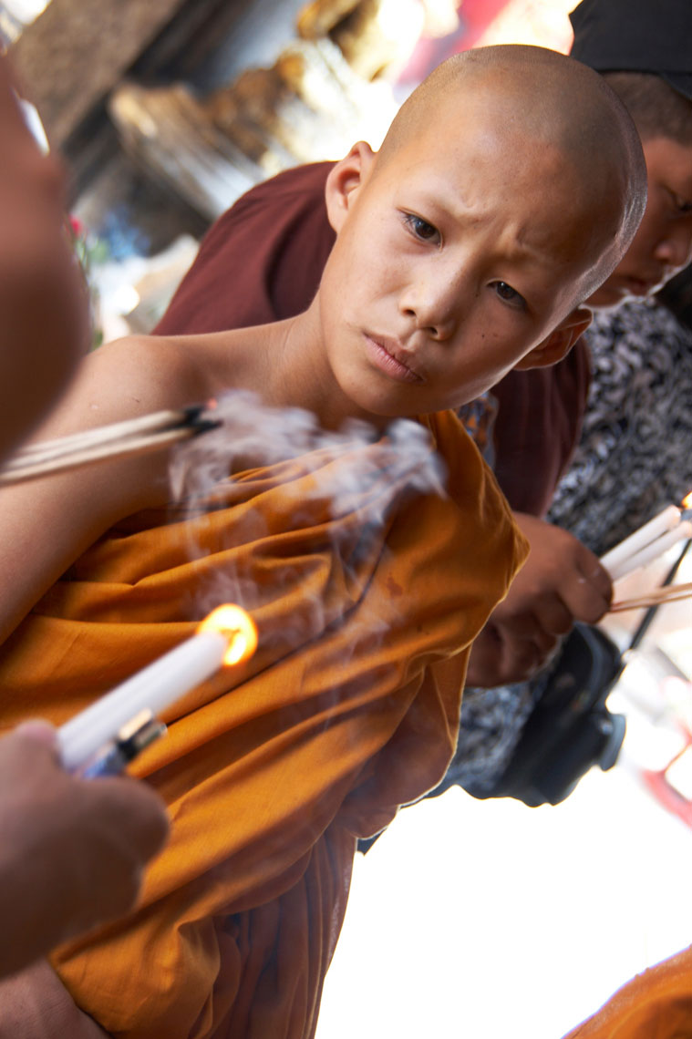 Young monk/burning incense/Thailand/location photography