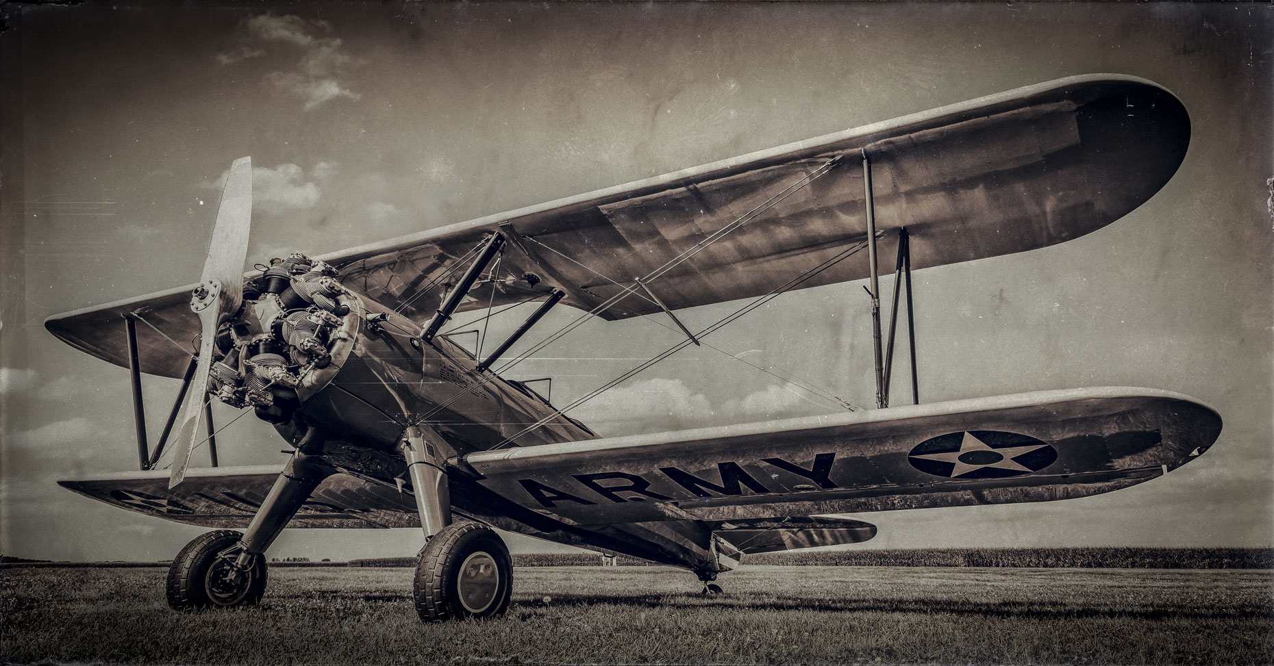 Old biplane/low angle/b&w/grass/aviation photography