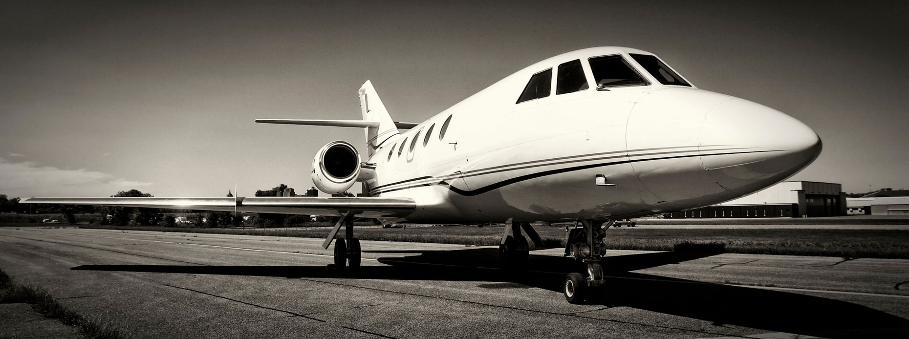 Private jet/b&w/wide angle pannoramic/runway/aviation photography