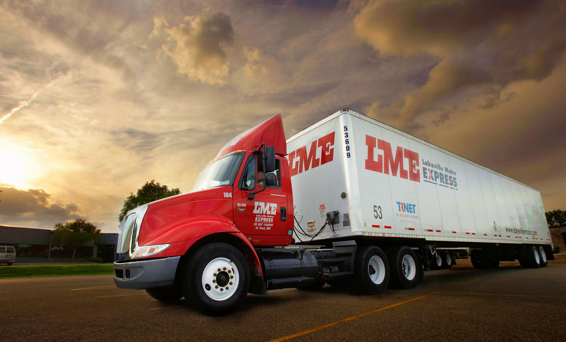 LME Semi truck/red/white trailer/sunset/location photography
