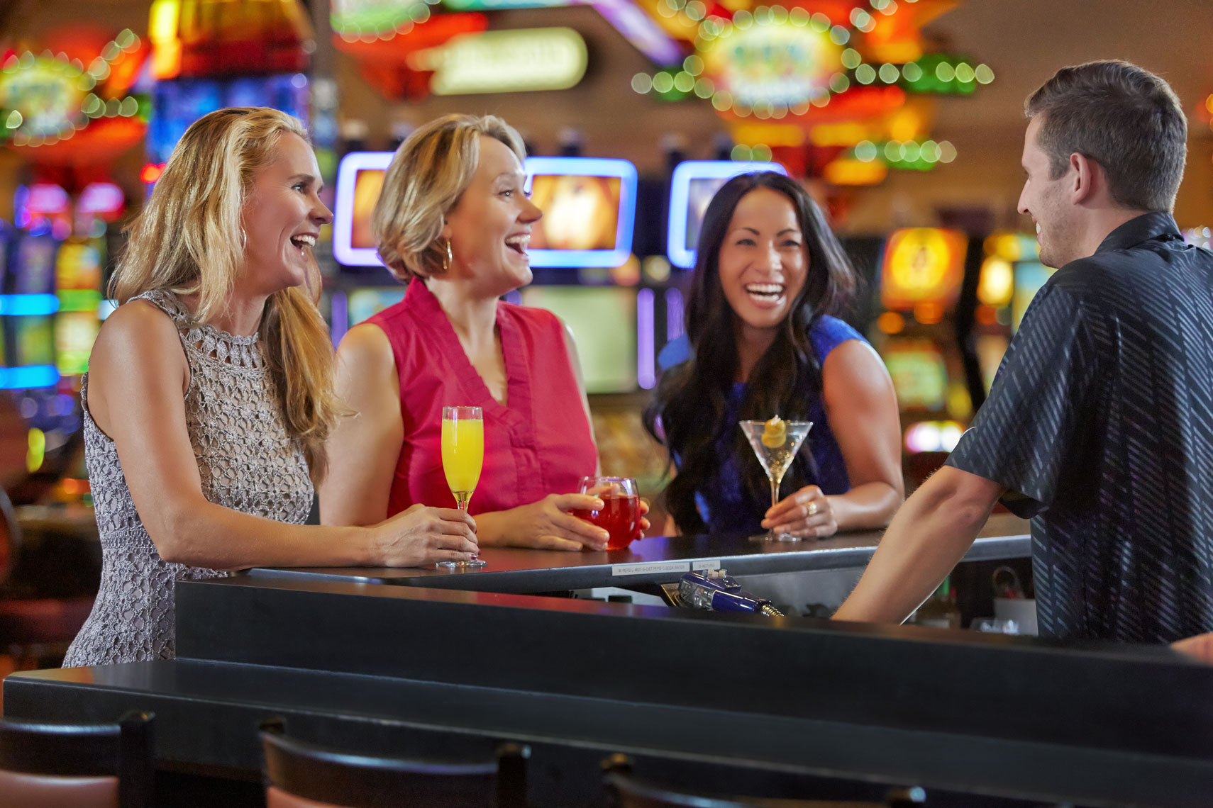 Little Six Casino/3 women at bar laughing/lifestyle people photography