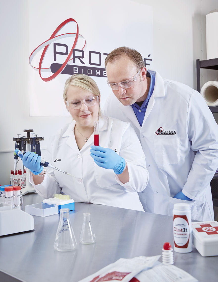 Protege Biomedical/lab/two lab people/medical photography