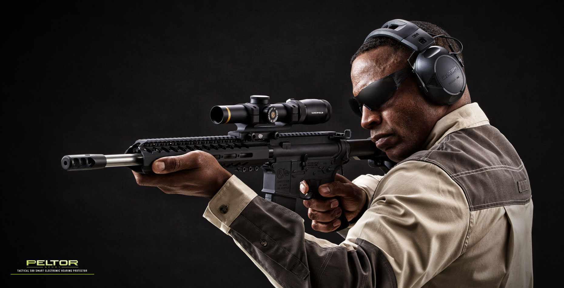 Peltor hearing protection/man/assault rifle/product photography