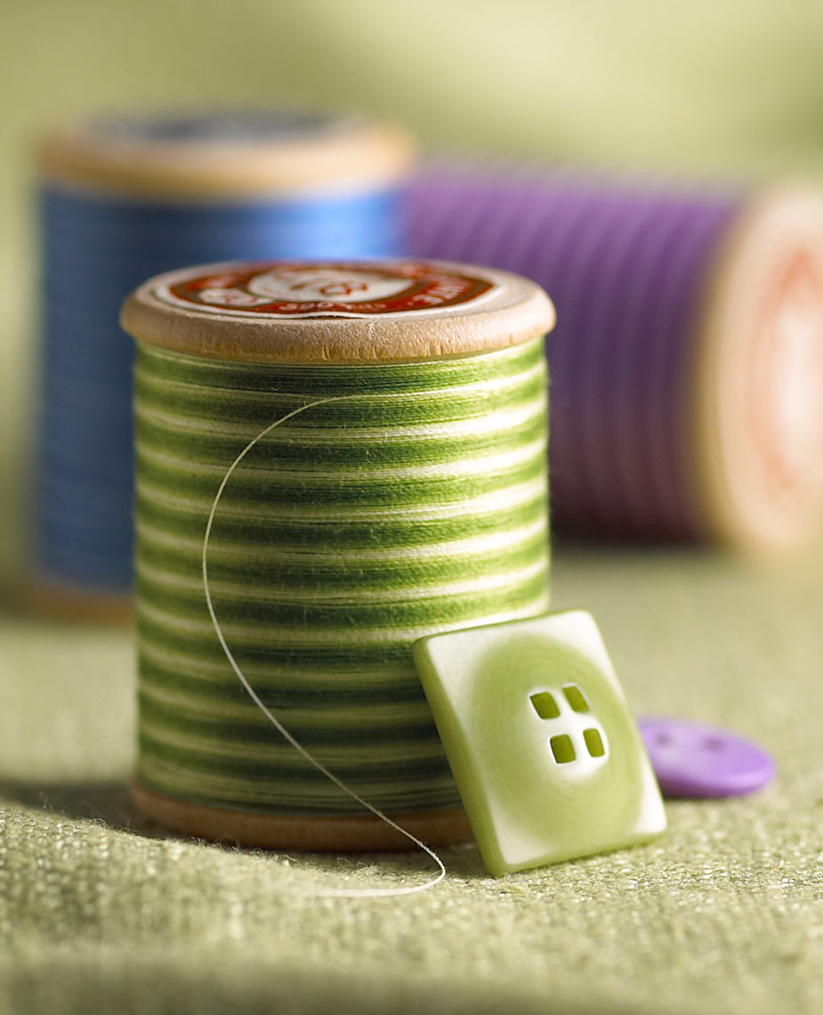 Spools/green thread/button/product photography