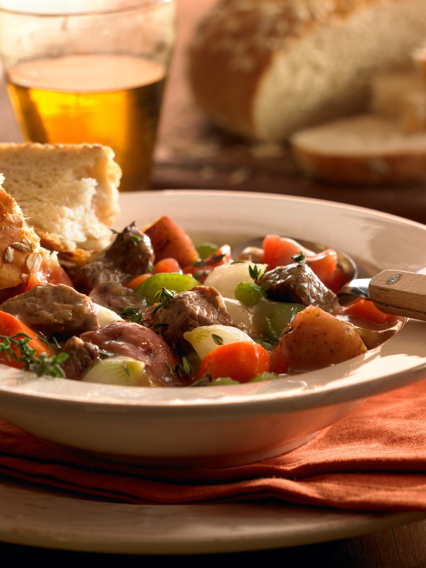 Beef and potato stew with veggies and a side of bread.  Food photography, InsideOut Studios.