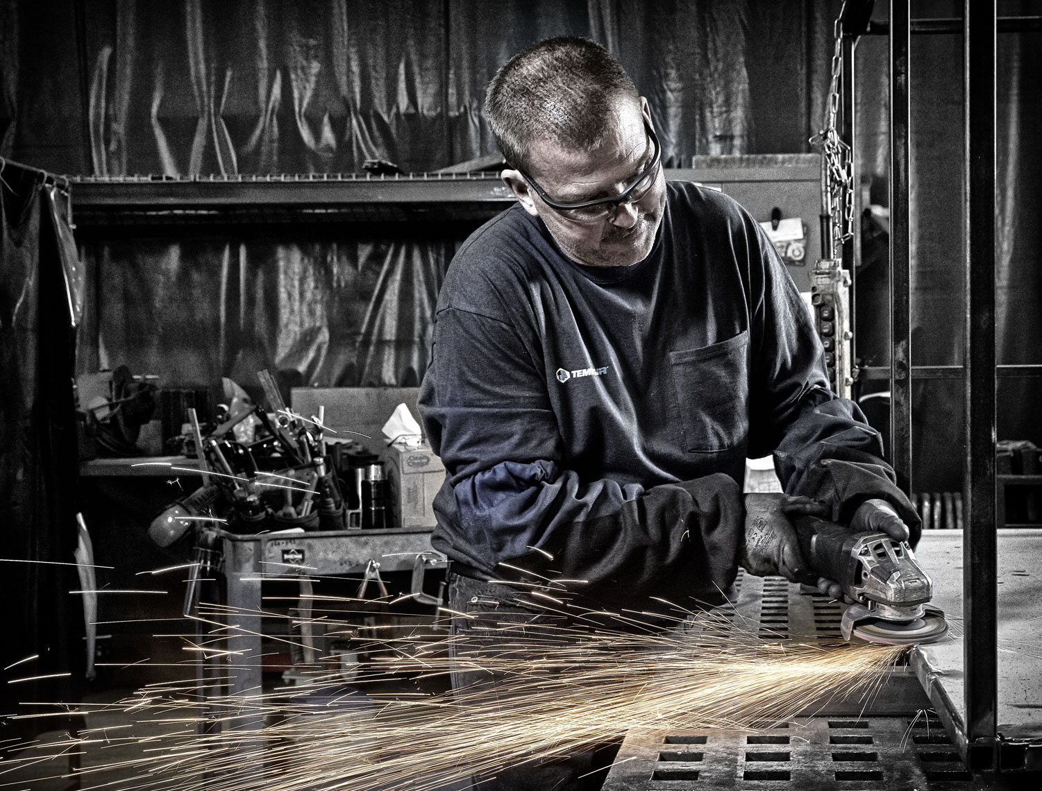 Tempair/worker grinding/sparks/b&w/lifestyle photo/InsideOut Studios