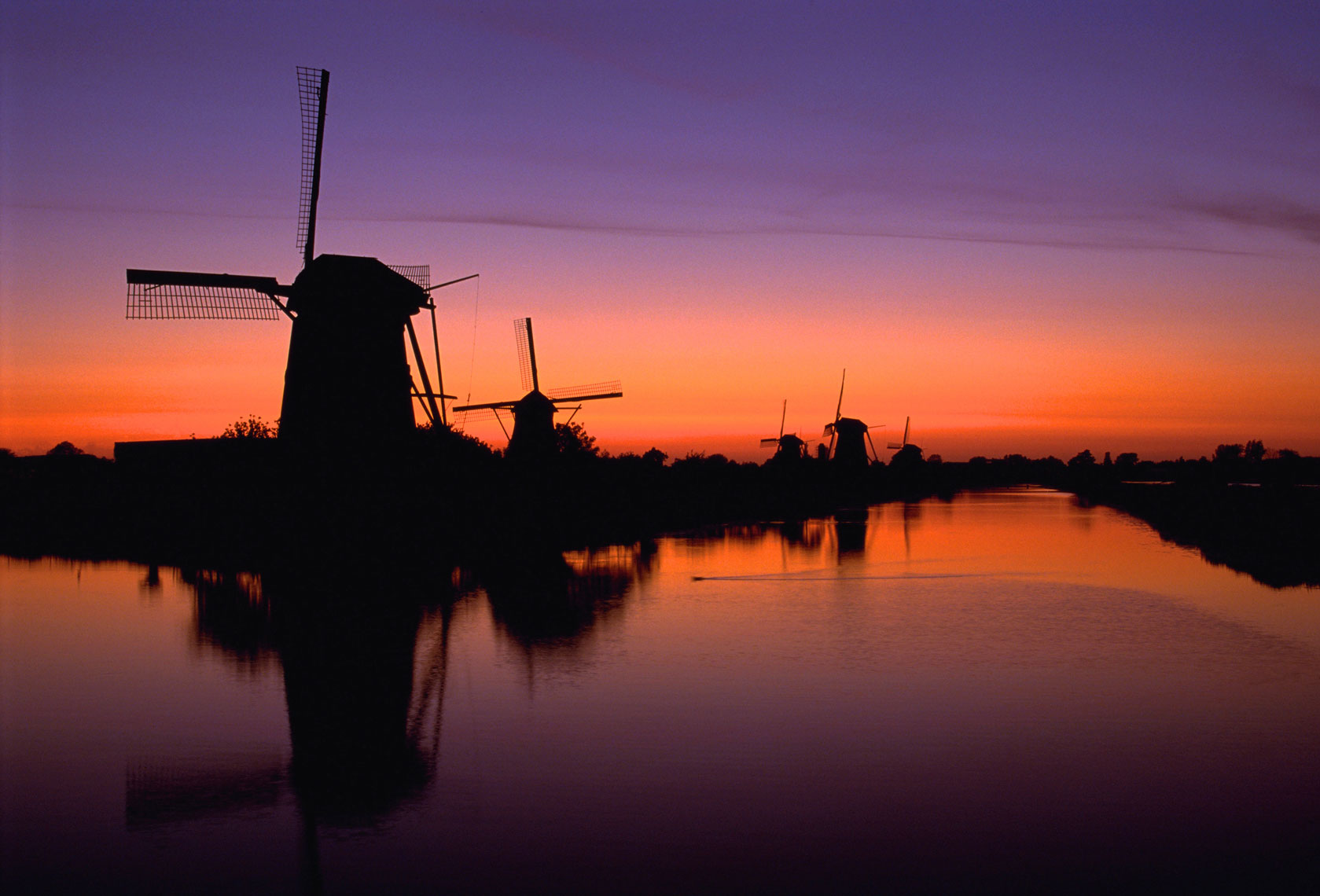 Windmills of Holland/Calm river/orange, purple sunset/locaton photography/InsideOut Studios