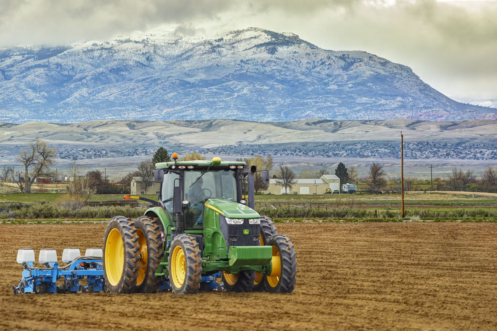John Deer tractor/plowing field/mountains/agriculture photography