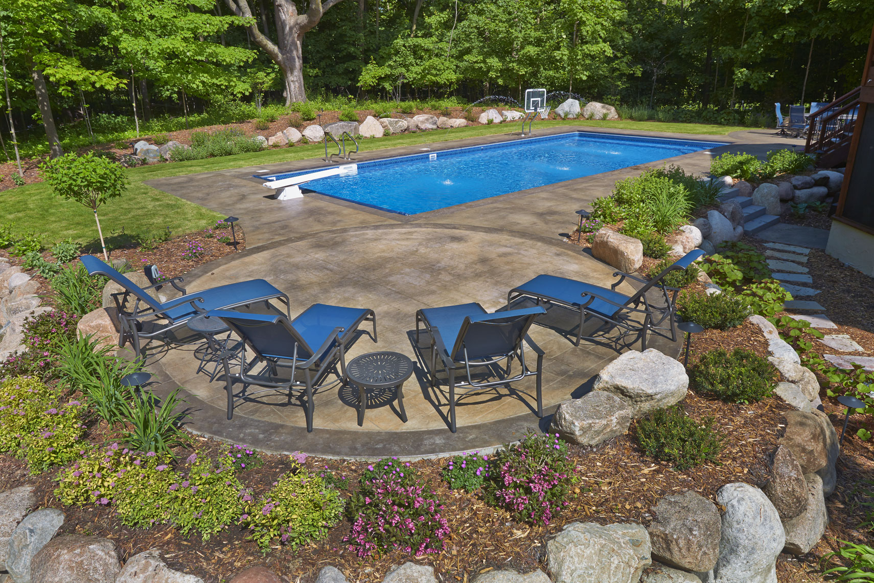 Pool in backyard/summertime/lg tile surround/location photography
