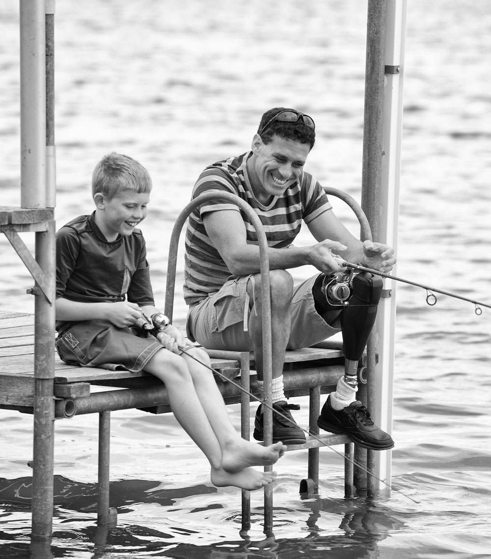 Father and son/fishing/prosthetic leg/dock/lifestyle photo