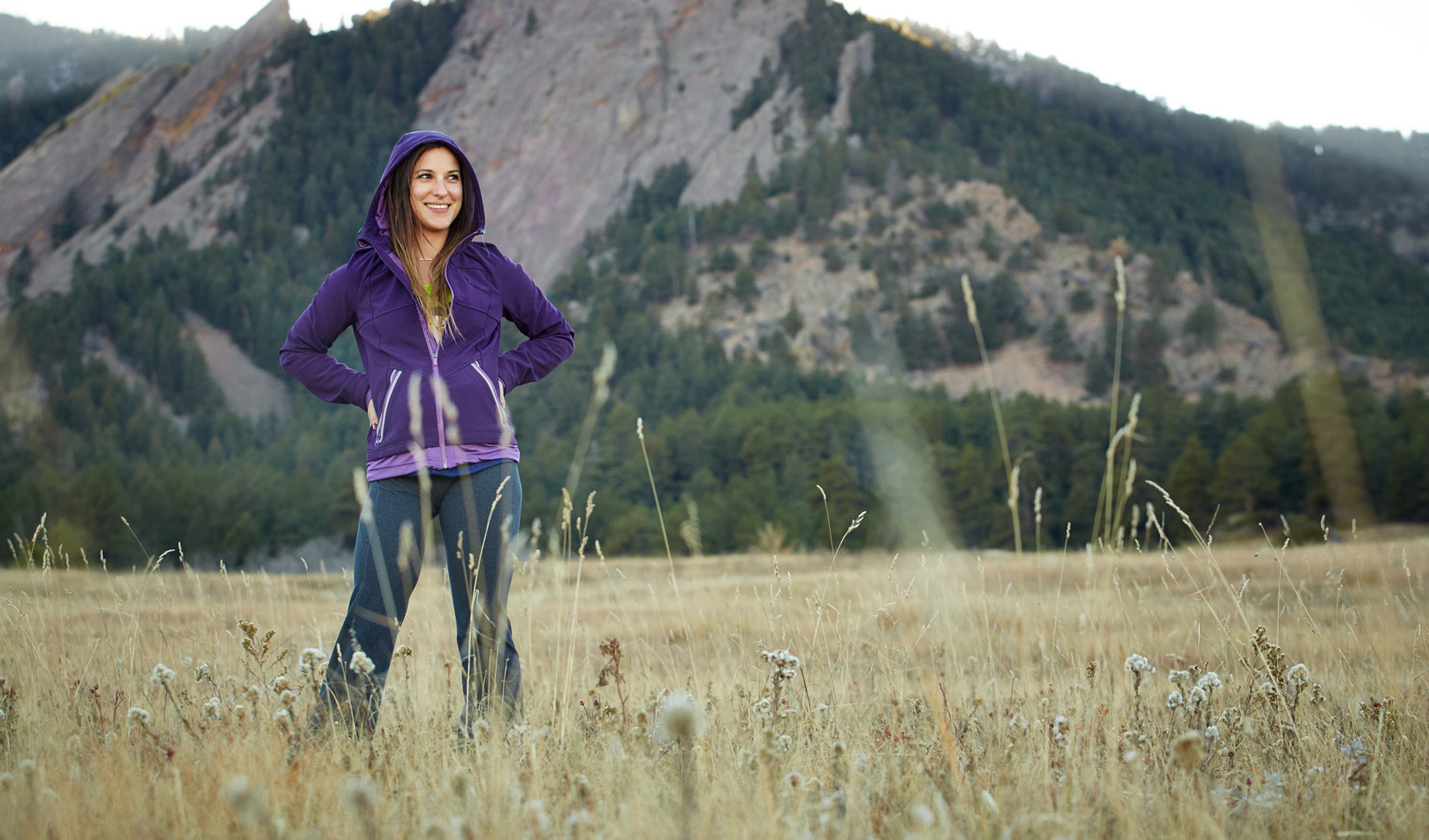 Otto Bock/woman in field/mountains/purple hoodie/lifestyle photography