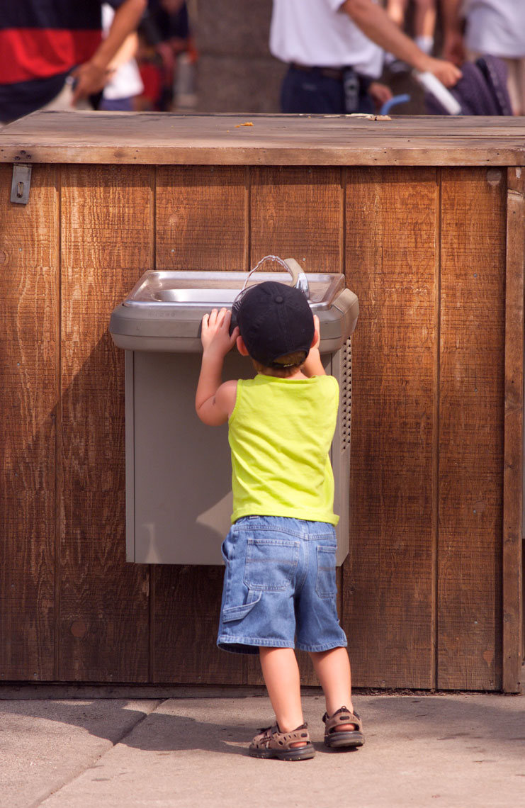 Small Boy/getting drink/water fountain/locaton photography